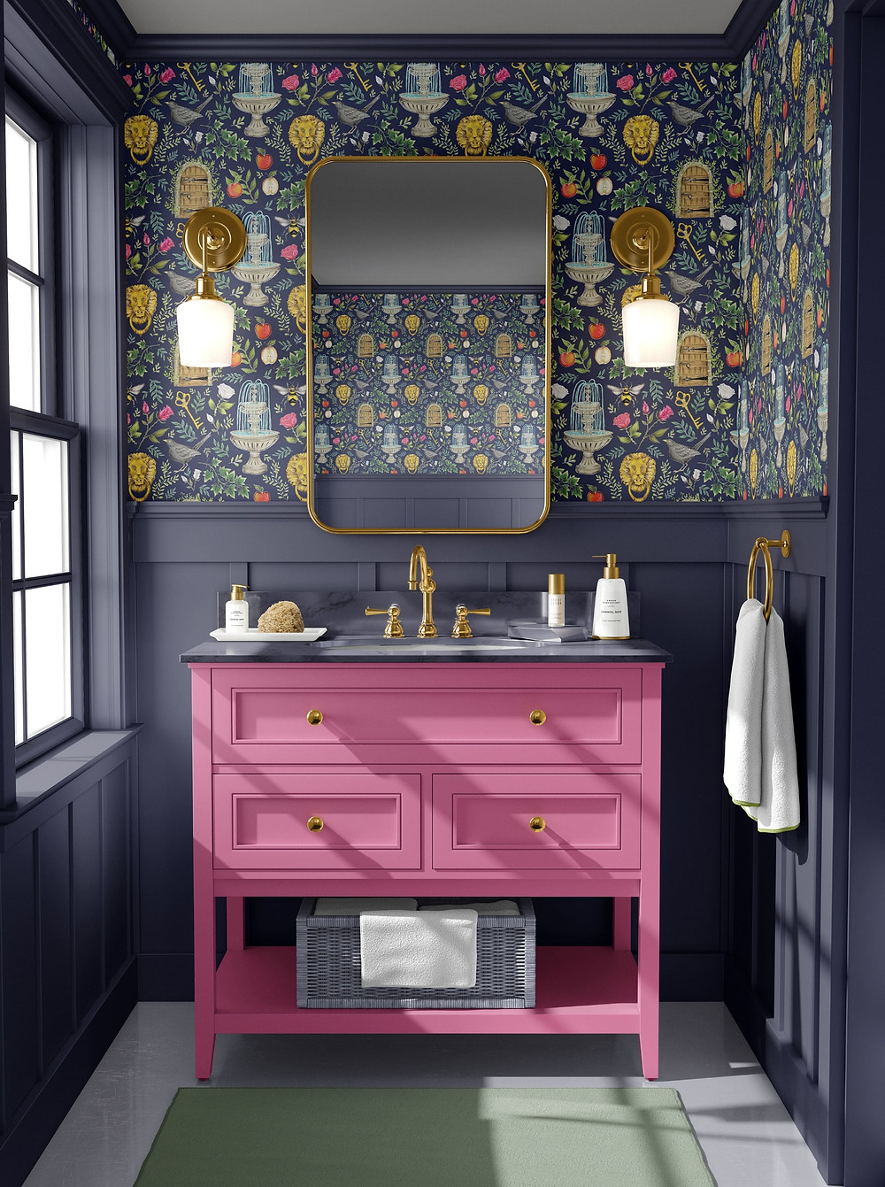 Small bathroom in dark blue tongue and groove with pink vanity unit and colourful wallpaper from Catherine Rowe, brass mirrors and wall sconces