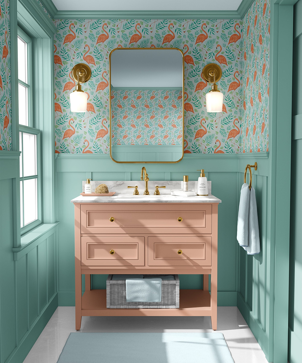 Small bathroom in mint green tongue and groove with peach vanity unit and colourful flamingos wallpaper from Catherine Rowe, brass mirrors and wall sconces