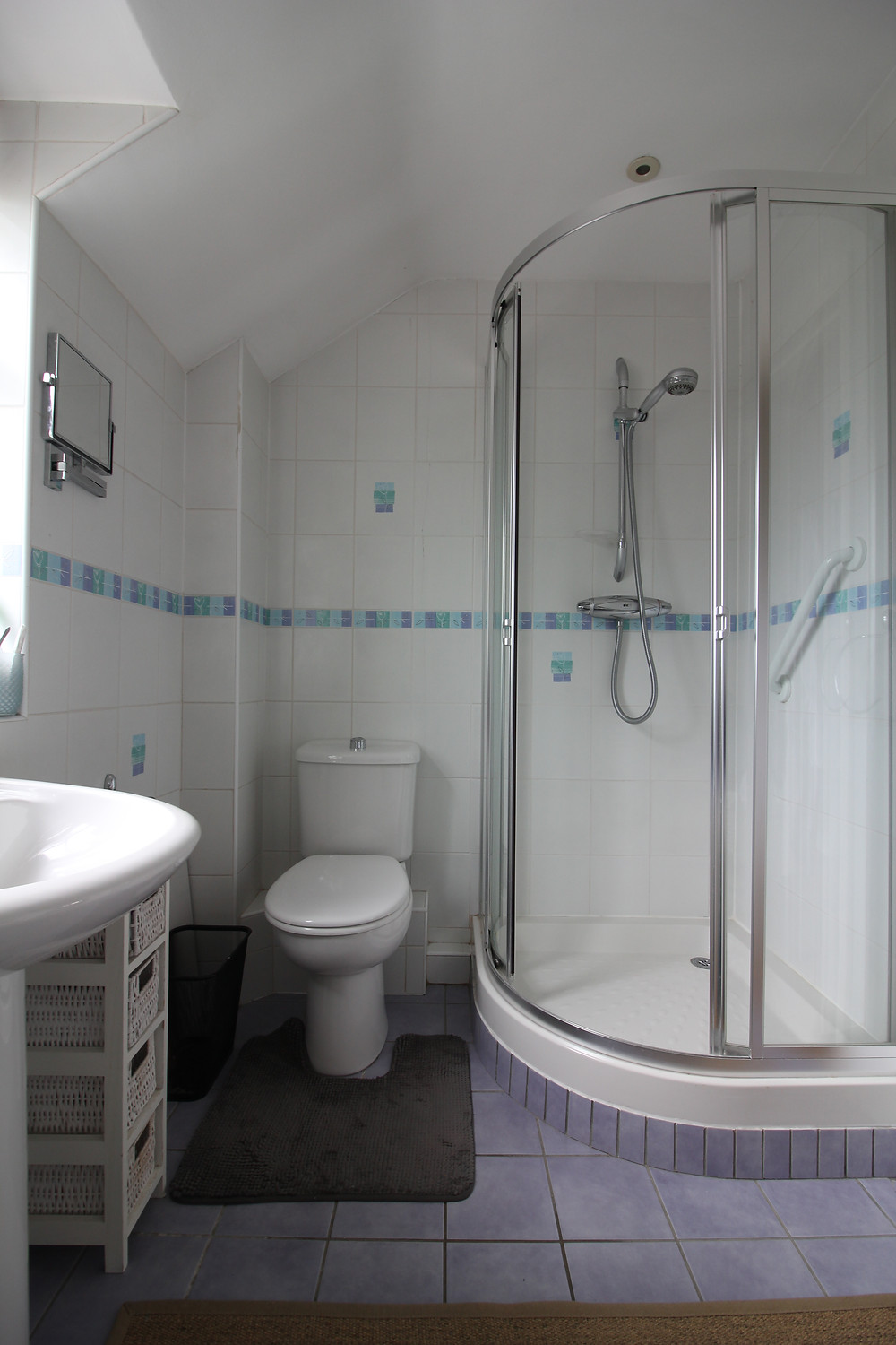 seasonsincolour bathroom makeover, a bathroom with square white tiles and blue border, chrome shower cubicle