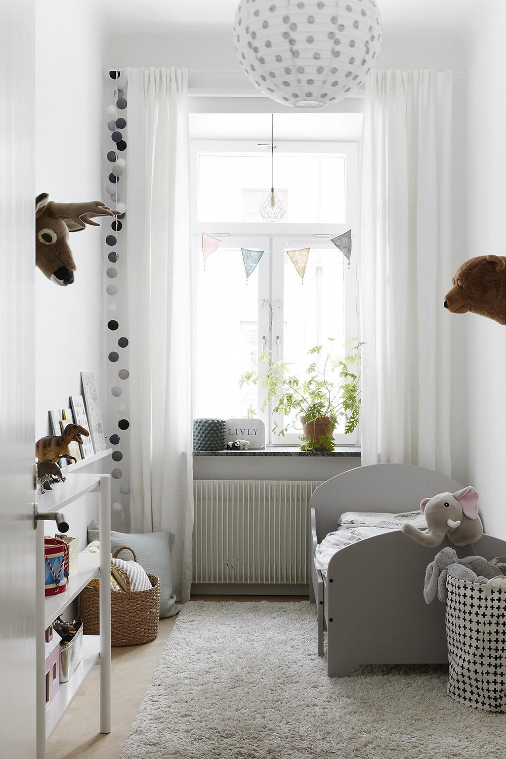 Scandinavian interior design kids room decor ideas animal trophies on wall