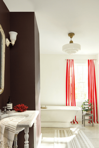 Bathroom decor with free standing bathtub and red white striped curtains. This is not completely modern, it is traditional. Interiors tips and ideas for a guest bathroom. Benjamin Moore has revealed Caliente AF-290 as its highly anticipated Colour of the Year 2018. Unveiled alongside a corresponding palette consisting of 22 enlivening hues, this vibrant and charismatic shade of red is a bold yet soothing contemporary colour that oozes confidence.