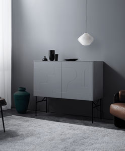Superfront sideboard with an Original BTC pendant over it and a collection of black vases.