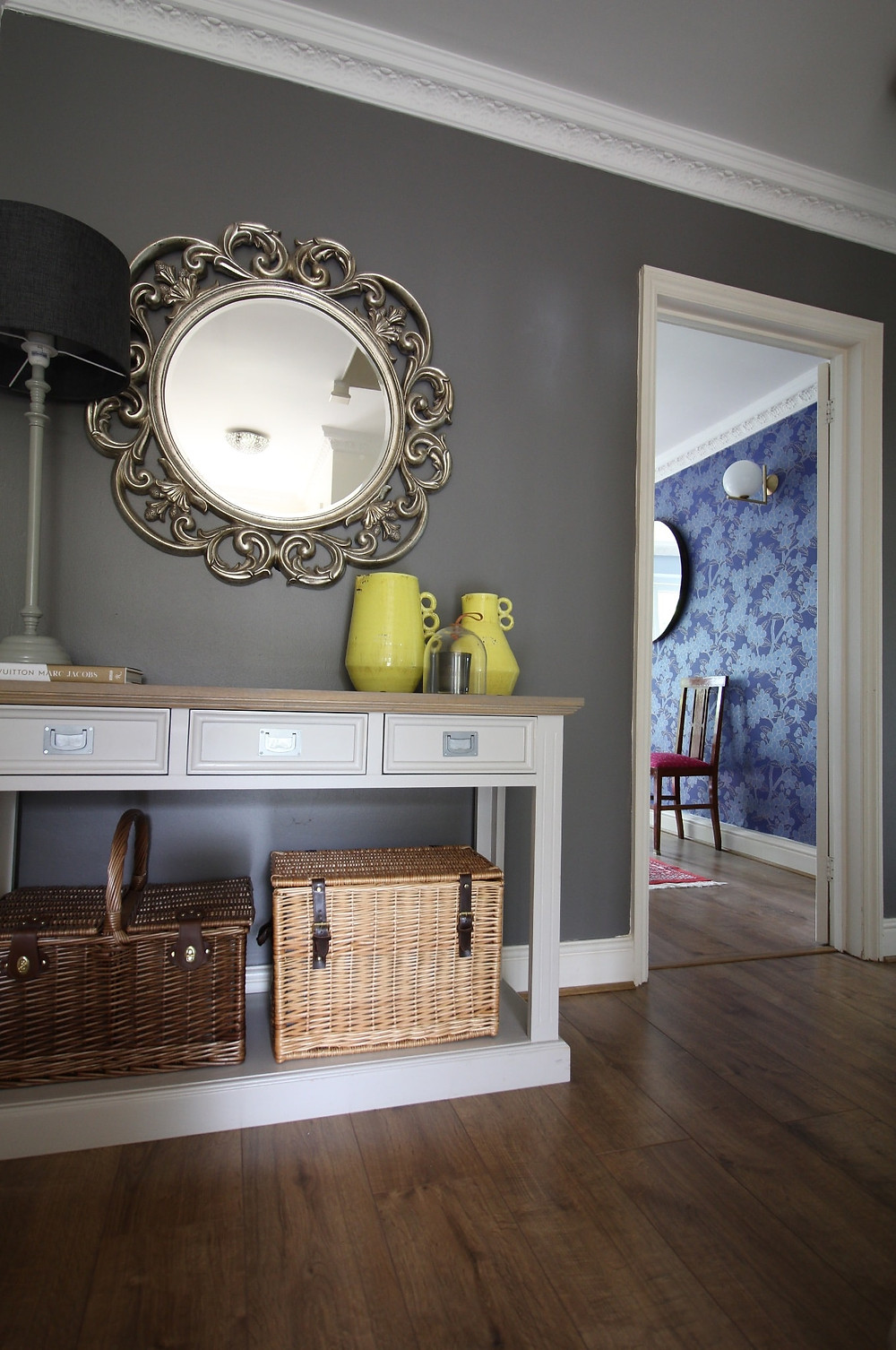 hallway in Farrow and ball Moles Breath and round silver mirror, picnic basket
