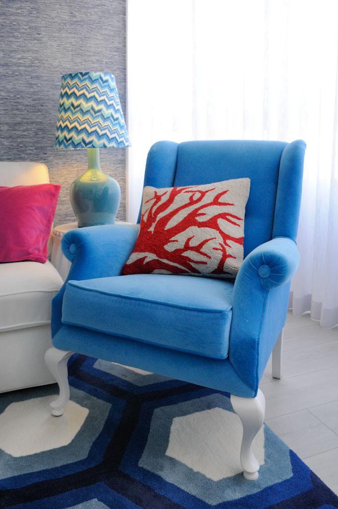 Interior design tips and ideas, living room decor, blue grasscloth wallpaper, coastal home, Palm Beach vibes, white sofas with blue cushions, chevron lampshade. Blue armchair. Sheer curtains