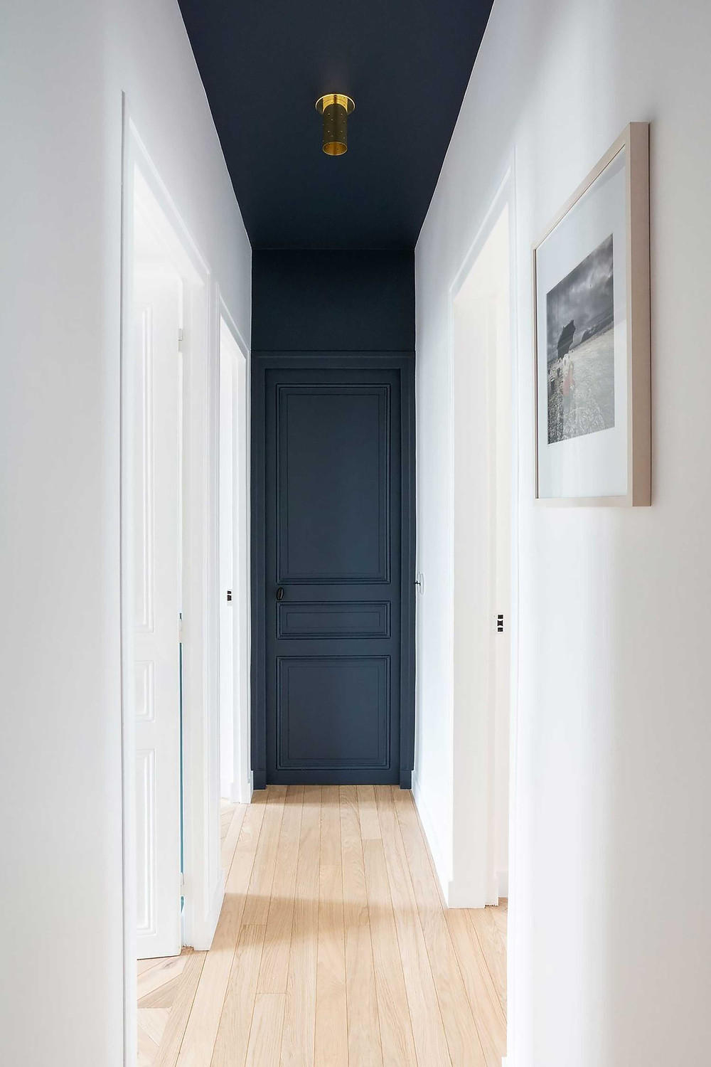 Creative ways to use paint around your home | Corridor ceiling painted in dark blue colour painted by hand | Seasons in Colour Interiors Blog