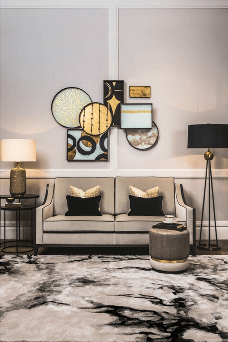 Luxury home decor, living room inspiration with sofa in cream and black piping, abstract art on the wall and viscose rug