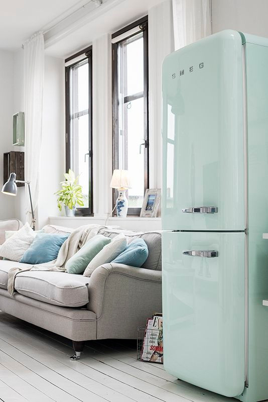 The mint green SMEG fridge in an open plan kitchen