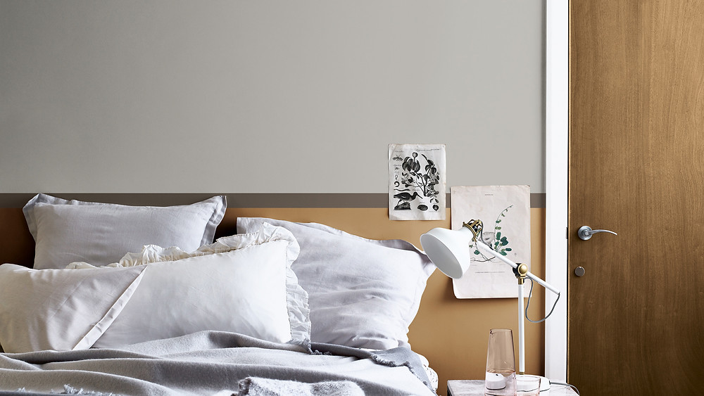 Spiced Honey is the Dulux Colour of the Year 2019 bedroom decor with white linen cushions