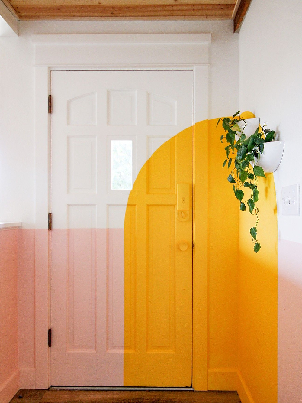Creative ways to use paint around your home | Painted arch effect on a door frame and adjoining wall in yellow colour | Seasons in Colour Interiors Blog