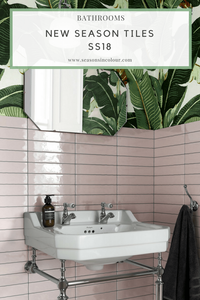 eclectic bathroom with pink tiles and wallpaper wit banana leaves