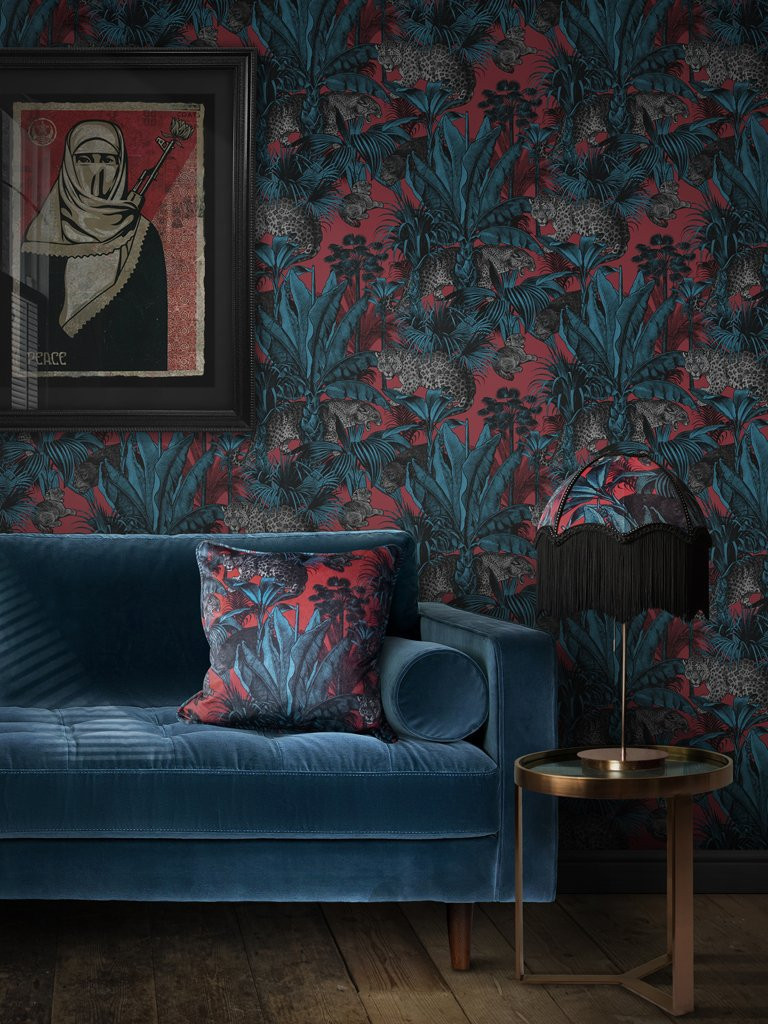 wallpaper divine savages leopards and floral, bold print and velvet sofa in blue and red