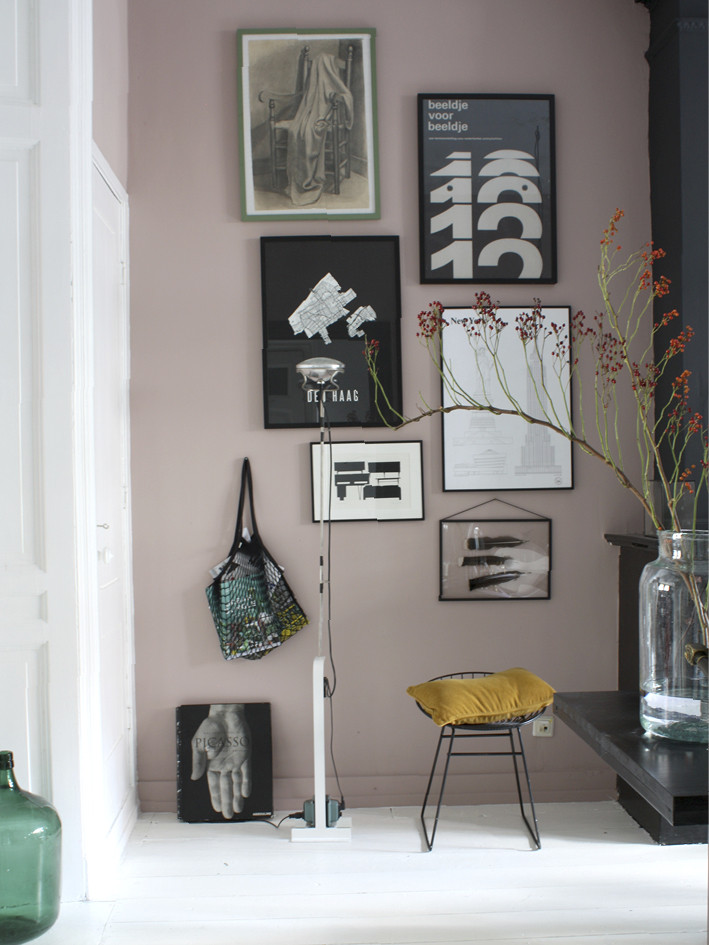 gallery wall pink with vase and red flowers black prints