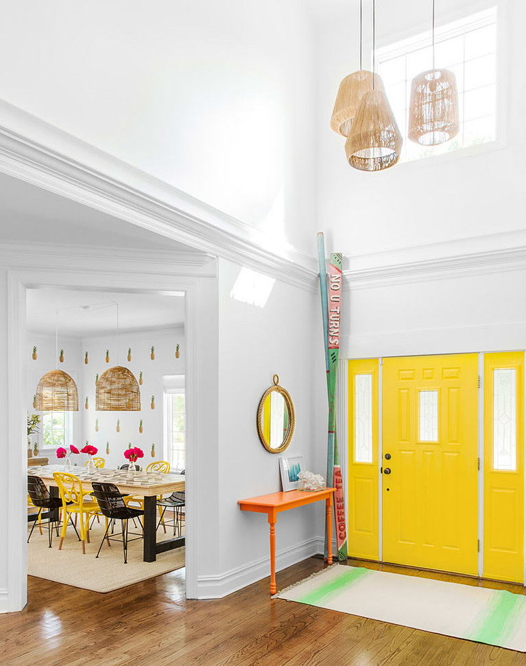 Yellow Entrance Door and double height ceiling leading into dining room. Images by SEAN LITCHFIELD / CHANGO & CO.