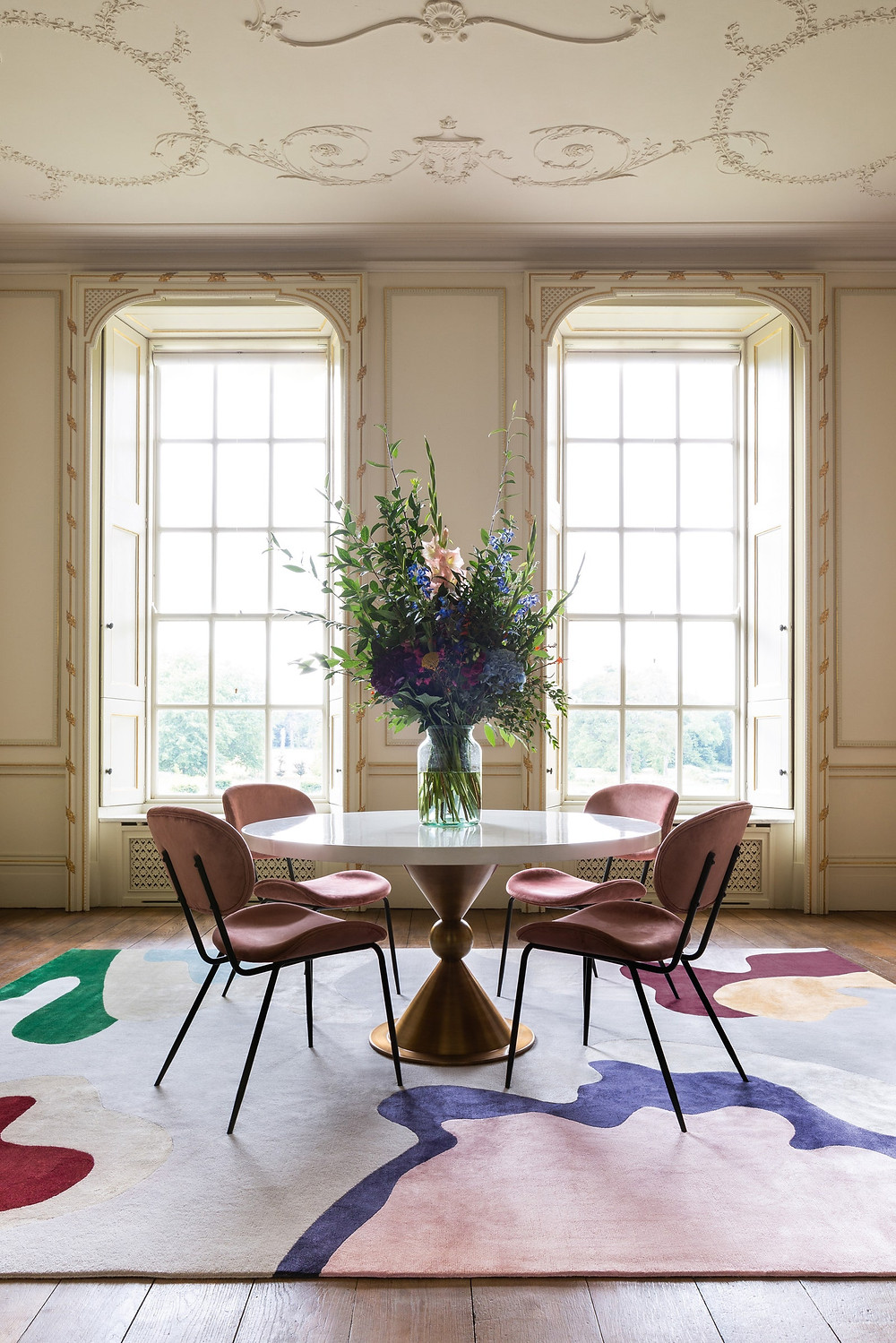 abstract rug by Mary Katrantzou in a living room using Jonathan Adler furniture