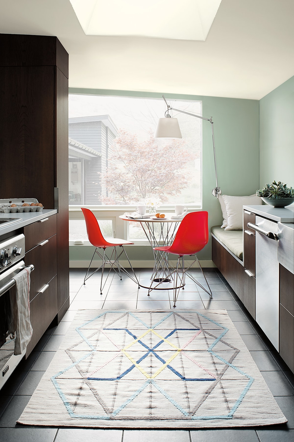 Kitchen decor with red Eames chairs and Tolomeo wall light Benjamin Moore has revealed Caliente AF-290 as its highly anticipated Colour of the Year 2018. Unveiled alongside a corresponding palette consisting of 22 enlivening hues, this vibrant and charismatic shade of red is a bold yet soothing contemporary colour that oozes confidence.