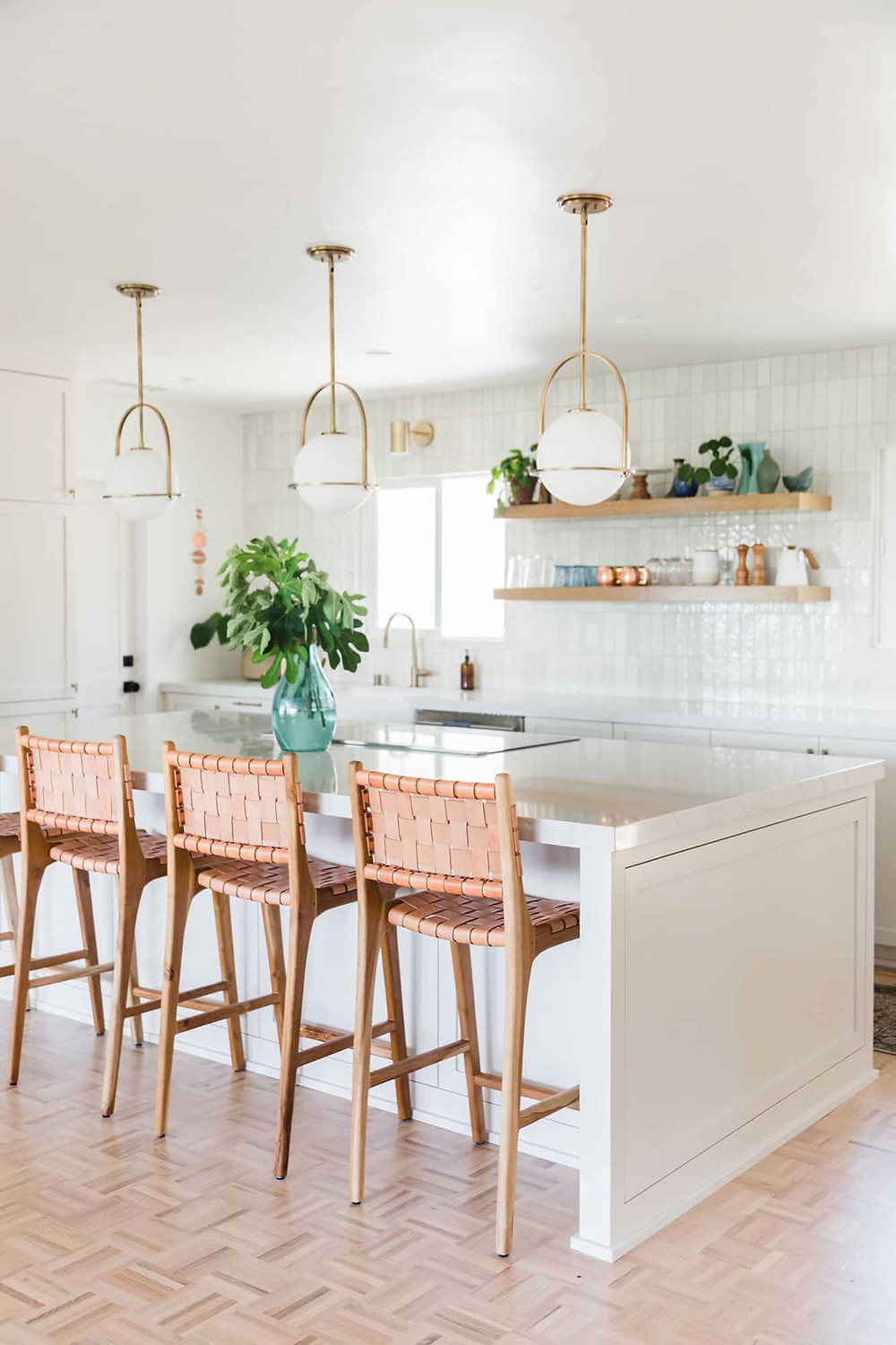 20 White Kitchen Design Ideas white cabinets in kitchen with large island and brass pendants