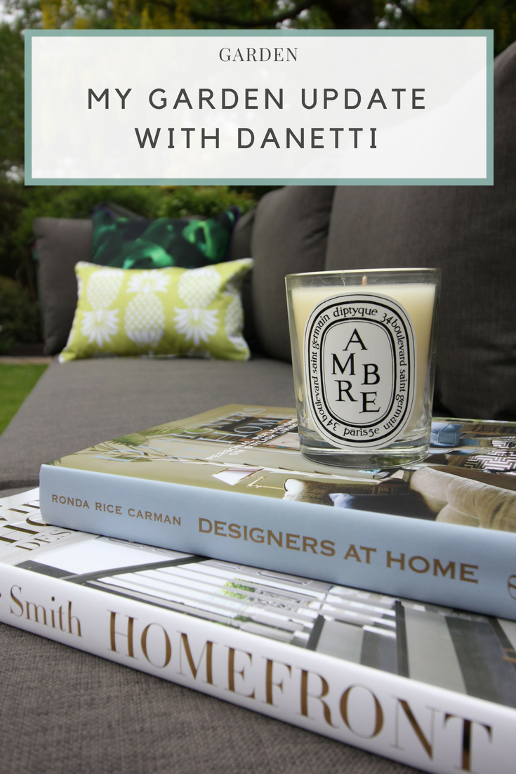 Danetti palermo garden bench and coffee table, Diptyque candle on a designer book