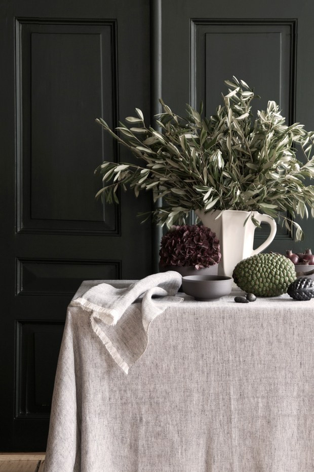 minimalistic decor with linen tablecloth in dark background