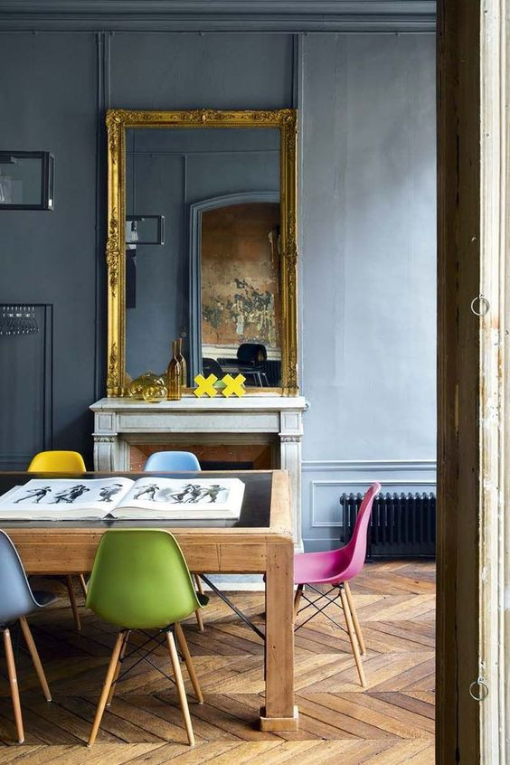Fred Meylan home in Paris with vintage Eames chairs in many colours and gilded mirror