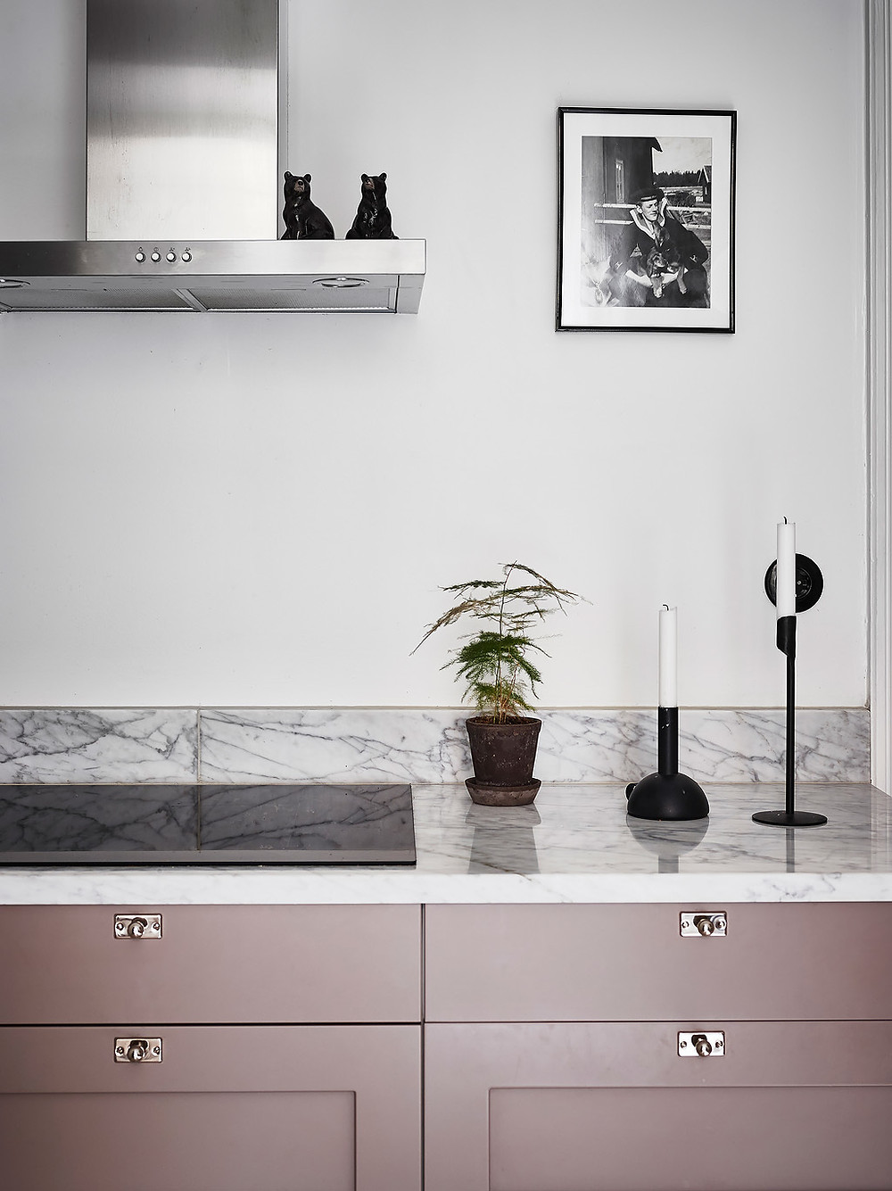 pink cupboards in kitchen and marble worktop