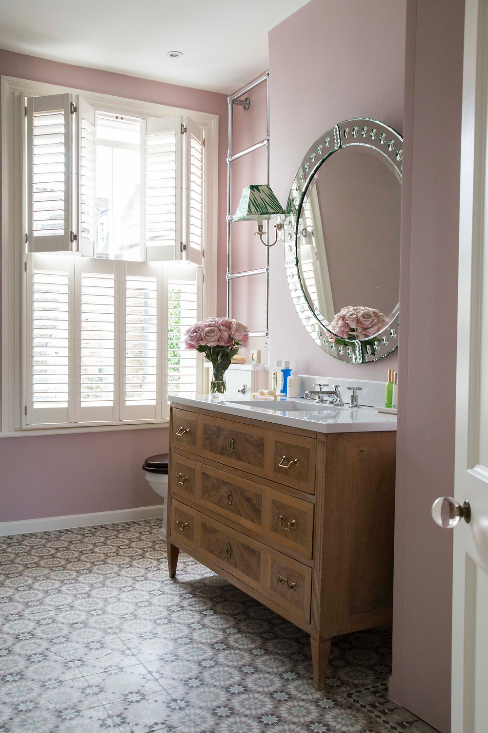 FAMILY BATHROOM in English style with pink walls and large venetian mirror, repurposed chest of drawers