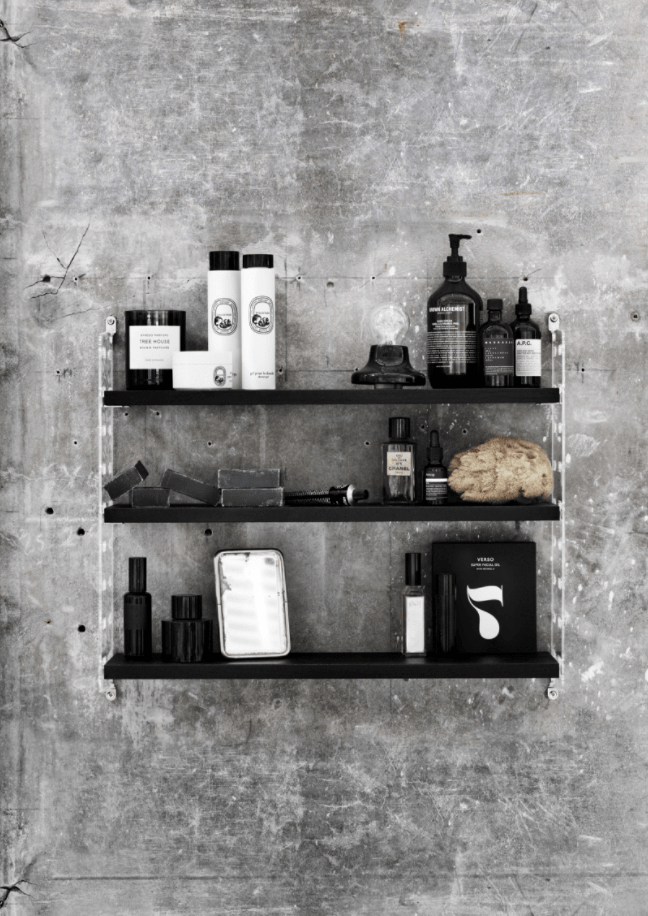 Black String Pocket shelving frame with bathroom accessories