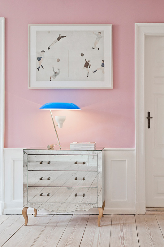pink wall and blue lamp
