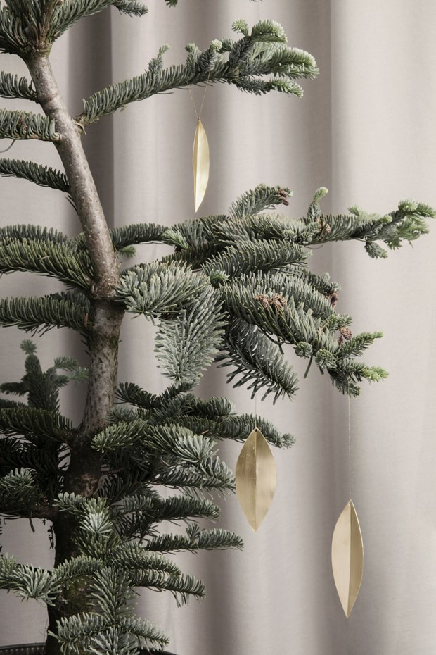 brass Christmas ornaments on a tree from Ferm Living