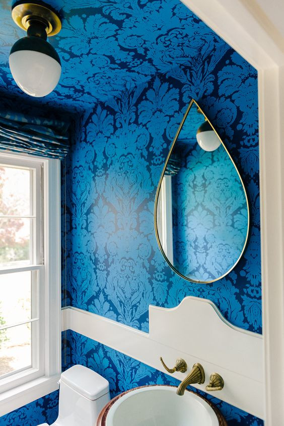 blue damask wallpaper on the walls and ceiling of a bathroom