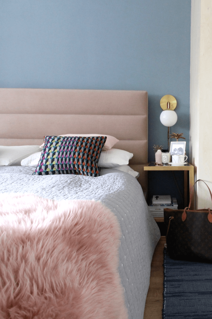 Margo Selby cushions on a bed that is upholstered pink and Denim Drift walls
