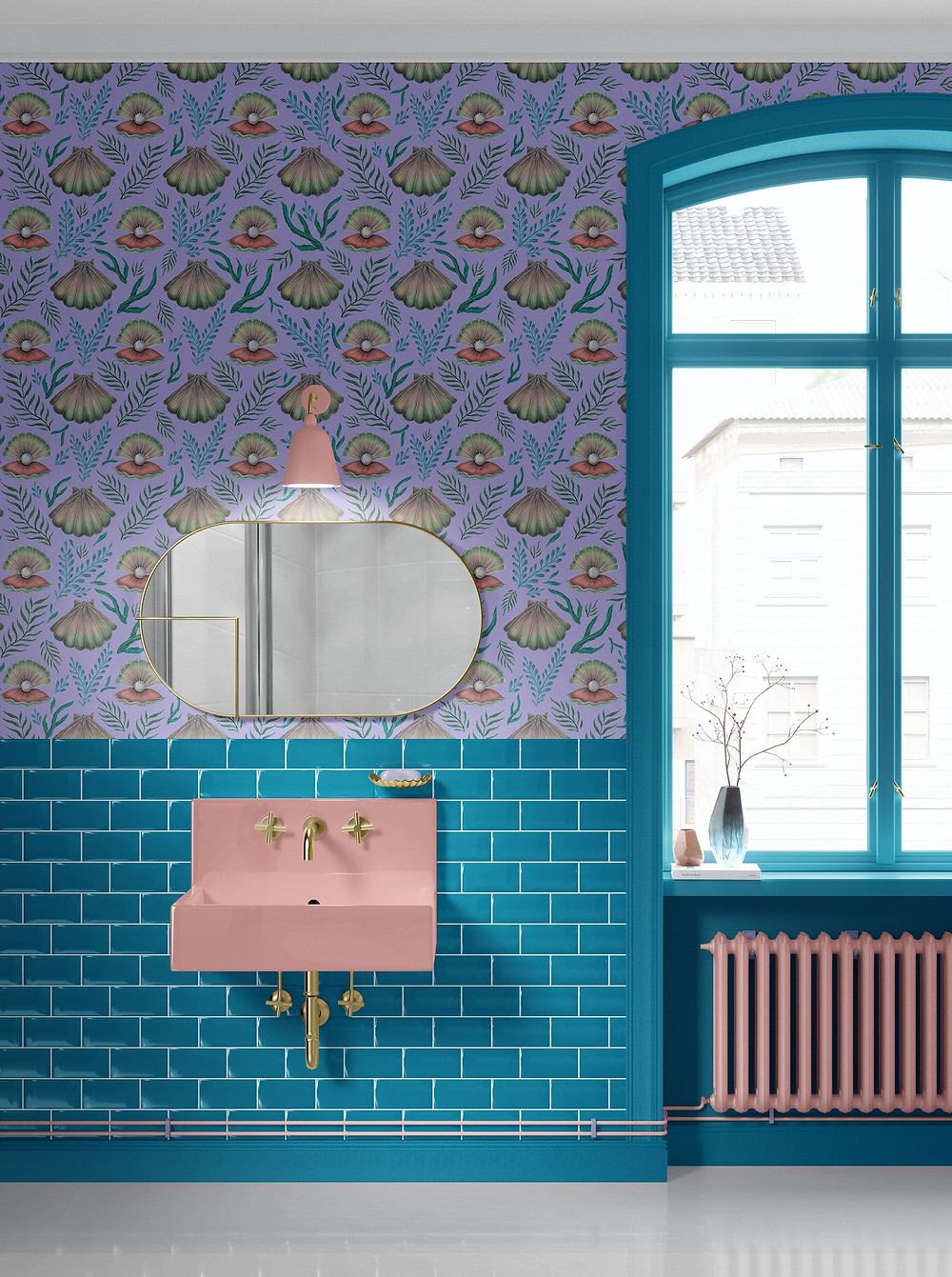 bathroom decorated with blue metro tiles and lavender wallpaper with shell and pearl design by Catherine Rowe. Round brass mirror and a pink wall light above the pink vanity sink