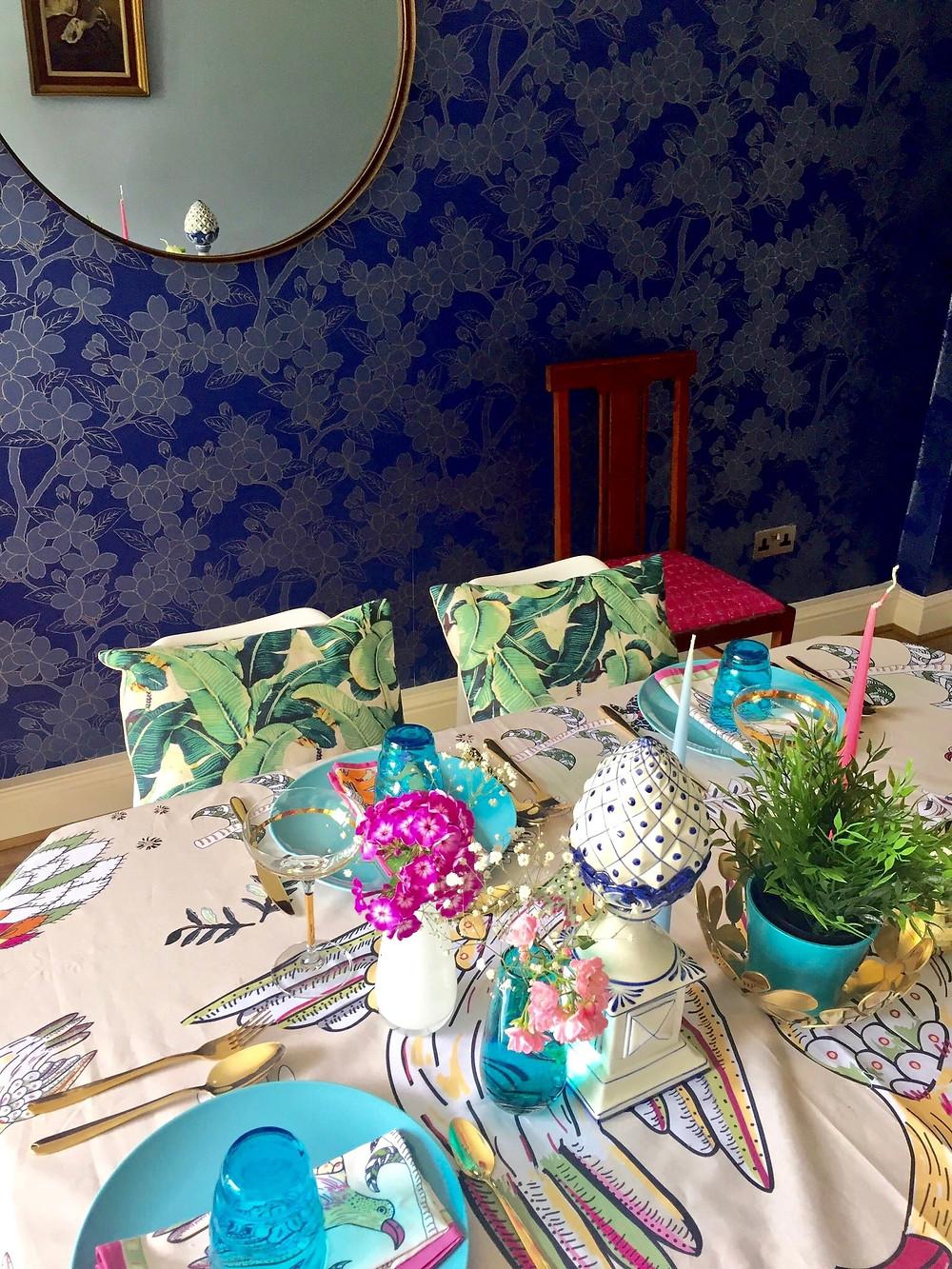 Camelia wallpaper Little Greene, banana leaf cushion, Flos wall light, round mirror, dining room, table setting