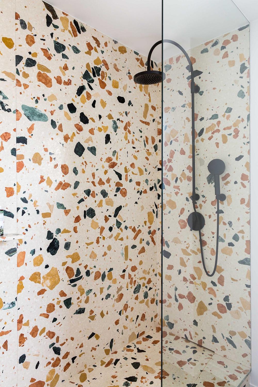 Bathroom for a Paris apartment, 2015,Marmoreal White slab, 2 cm thickness, honed finish. Photo, Brian W. Ferry, dzekdzekdzek.com black taps