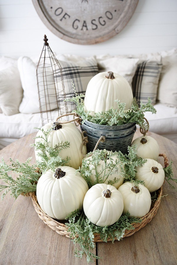 neutral decor inspired pumpkins on coffee table
