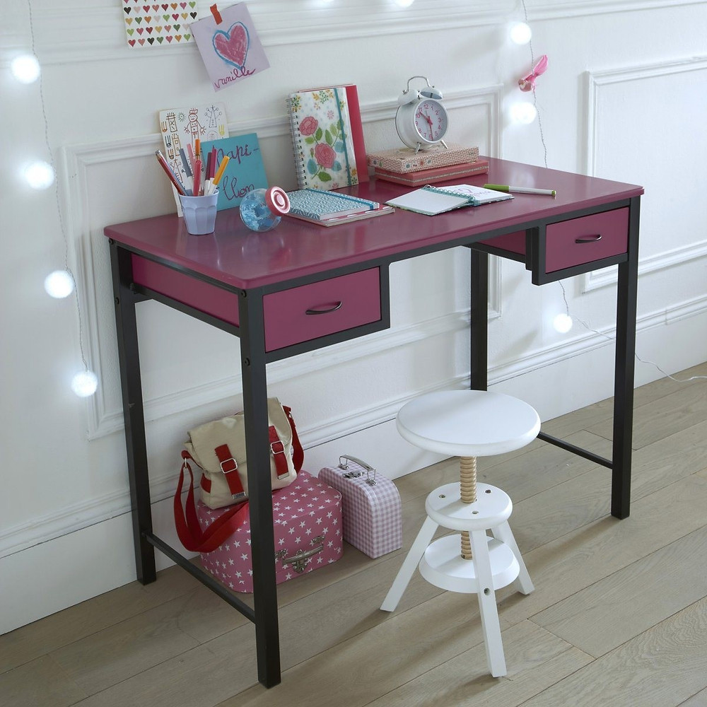 Made of solid birch, this stool has adjustable height. in front of a girl's workstation in pink with desk accessories