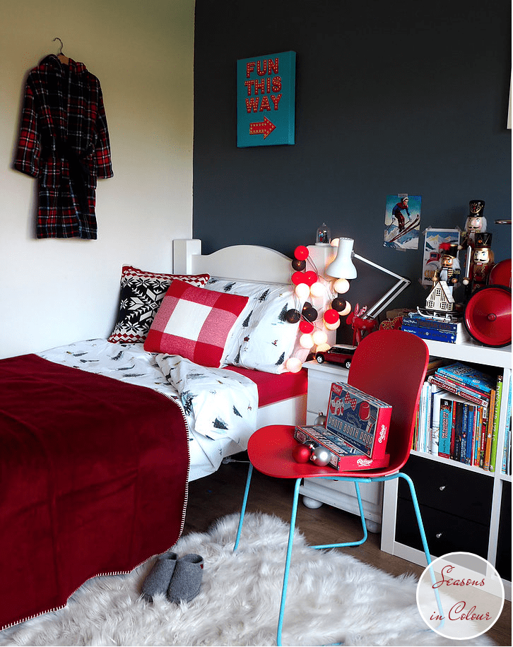 Junior Bedroom Christmas Styling white bed Dulux Steel Symphony 1 with retro toys and cotton ball lights, nutcrackers in the background and Anglepoise mini