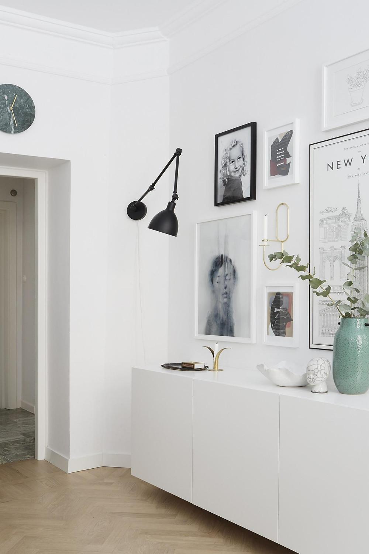 Scandinavian interior design living room black wall light and gallery wall over IKEA Besta unit, Ferm living accesories