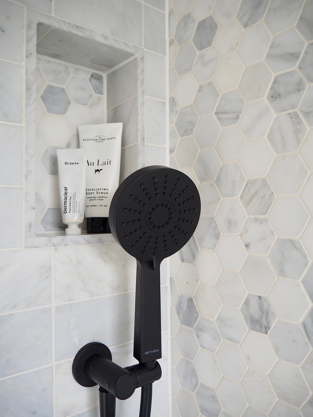 Methven Matt Black shower hand set and marble hexagon tiles from Mandarin Stone