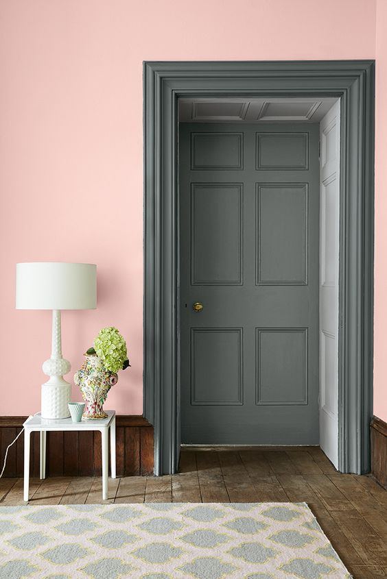 A wall painted in Confetti, doorway in Livid and a white lamp