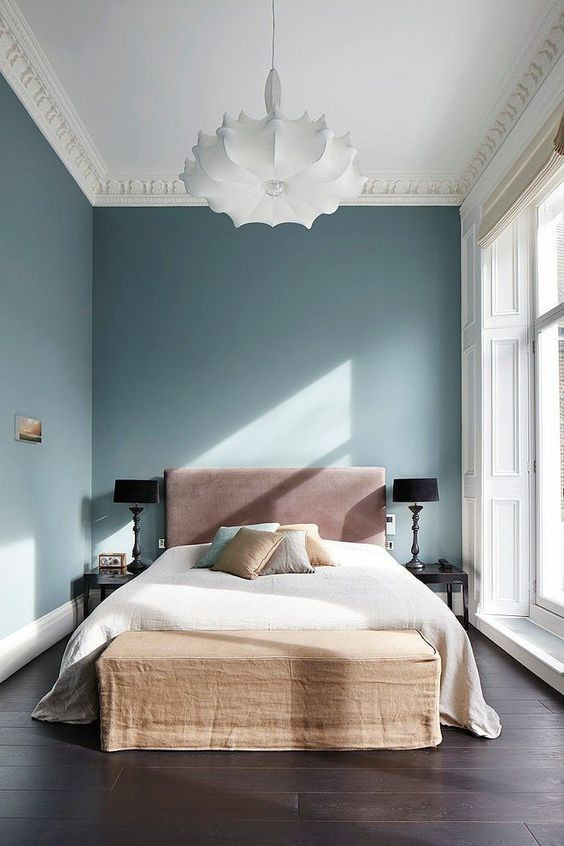 designer bedroom ideas and styling blue walls and white fabric lamp