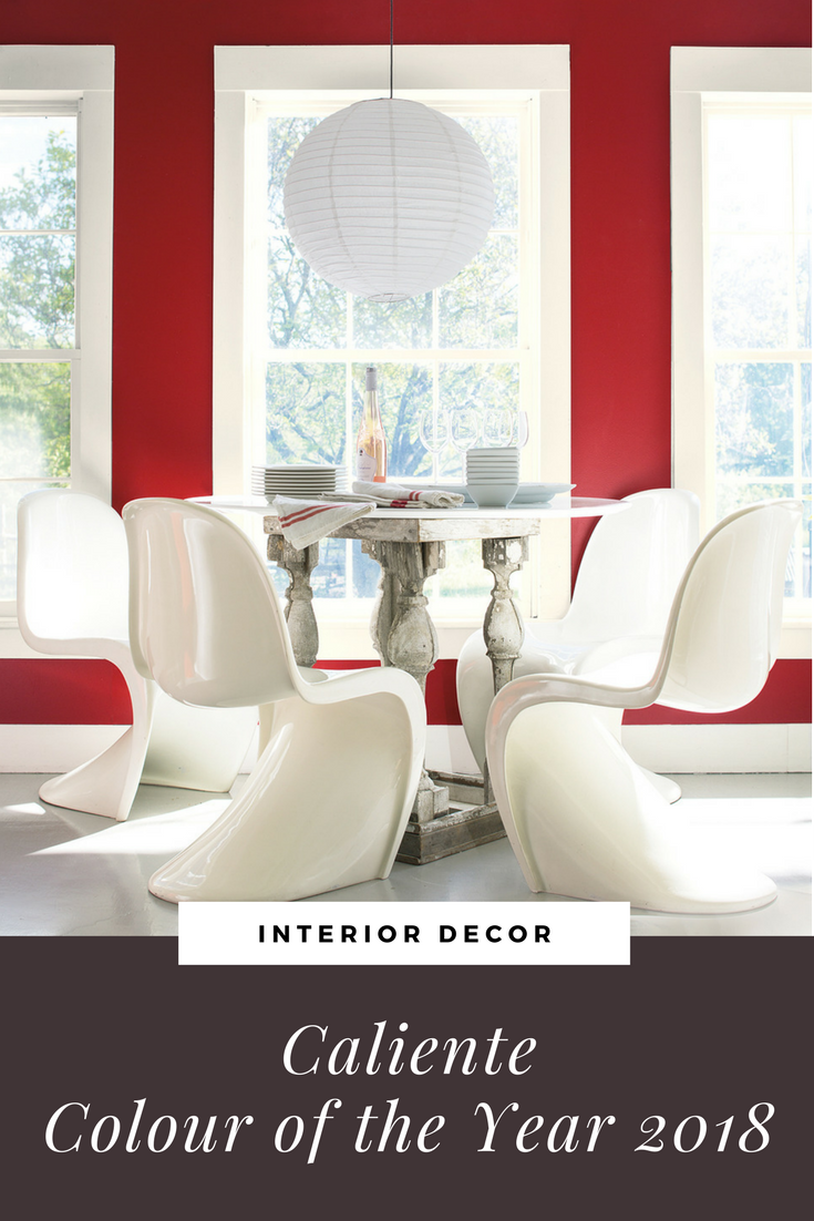 Dining room setting with MID CENTURY CHAIRS AND RUSTIC DINING TABLE while the walls are painted red. Benjamin Moore has revealed Caliente AF-290 as its highly anticipated Colour of the Year 2018. Unveiled alongside a corresponding palette consisting of 22 enlivening hues, this vibrant and charismatic shade of red is a bold yet soothing contemporary colour that oozes confidence. Wall colour - Caliente AF-290, Trim & Door colour - White Opulence OC-69