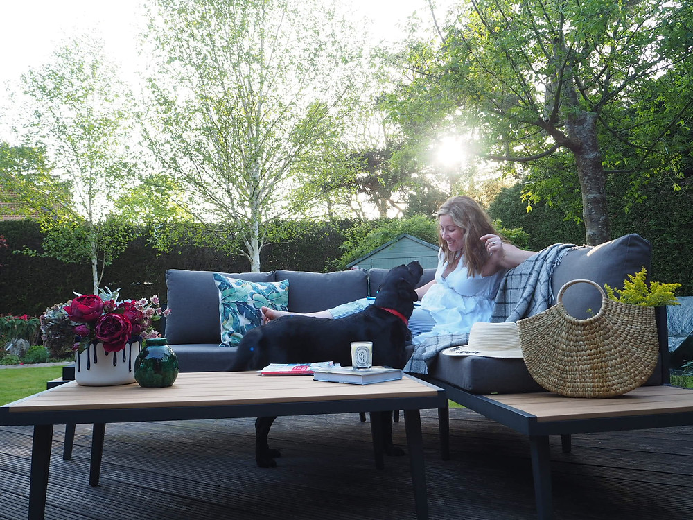 Danetti palermo garden bench and coffee table, Penelope Hope outdoors cushions, lounging in the garden and a black labrador