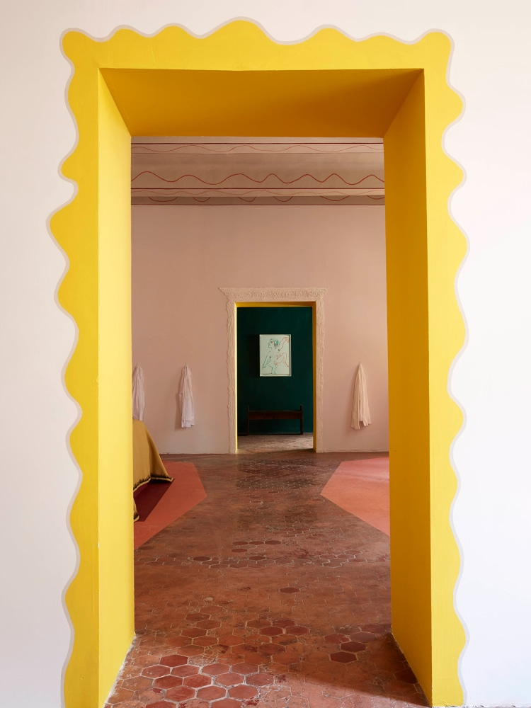 Creative ways to use paint around your home   Door frame with yellow scallop effect painted by hand   Seasons in Colour Interiors Blog