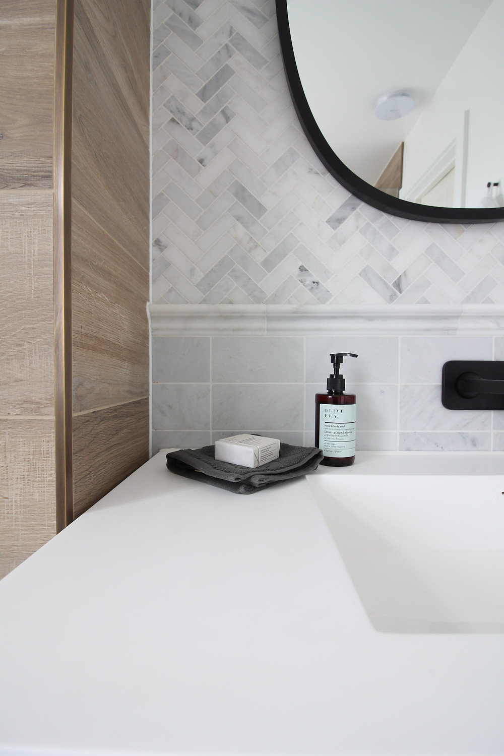 marble herringbone mosaic and marble metro tiles Mandarin Stone, and the Lusso PIANA 1000 vanity with resin Stone sink