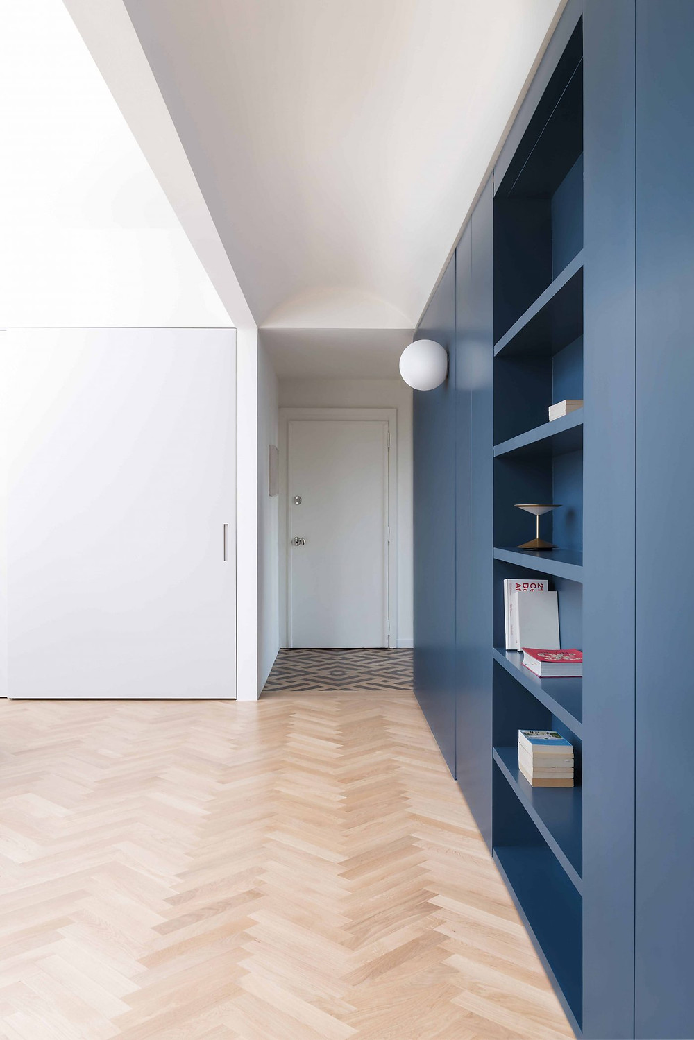 Blue bespoke bookcase cabinetry ideas | Milan's 1920s Ca' Brutta Building Penthouse by Studio Wok
