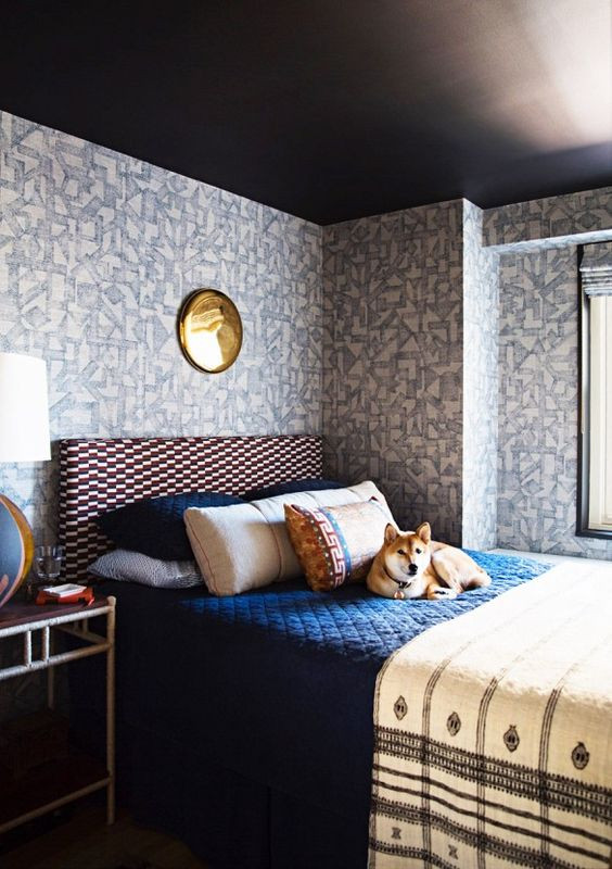 bedroom with wallpaper and charcoal ceiling
