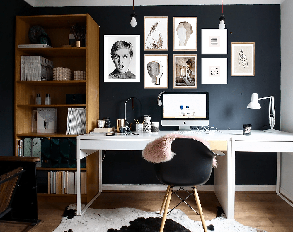 BLACK AND WHITE workspace with gallery wall and IKEA desks as well as a Billy bookcase.