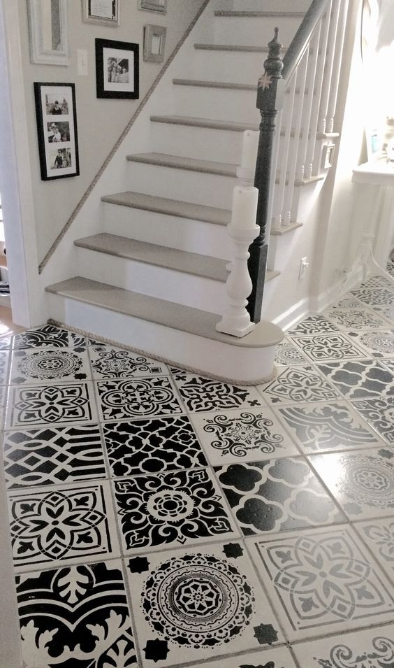 stencilled tiles hallway black and white
