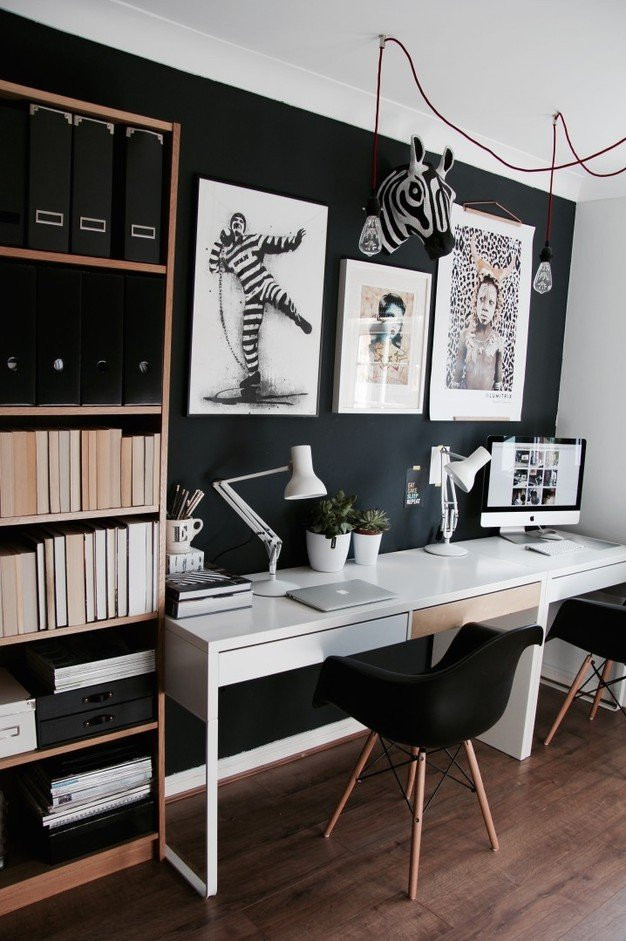 Eames black DAW chairs in an eclectic home office against Farrow and Ball Railings with Anglepoise white lamps and IKEA desk