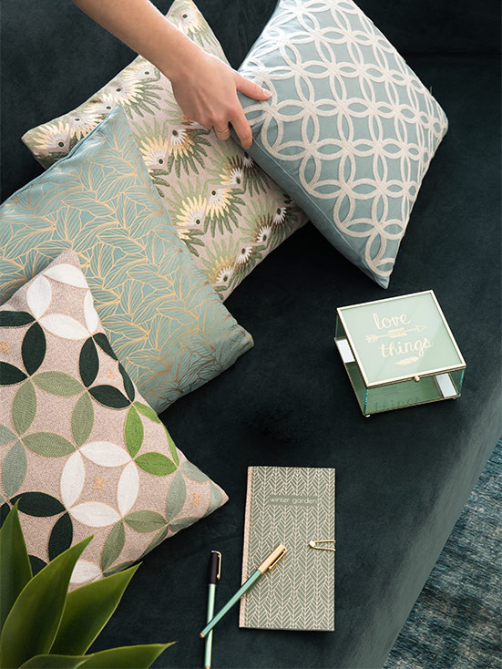 Green interiors is the latest Instagram trend cushions layers on a sofa